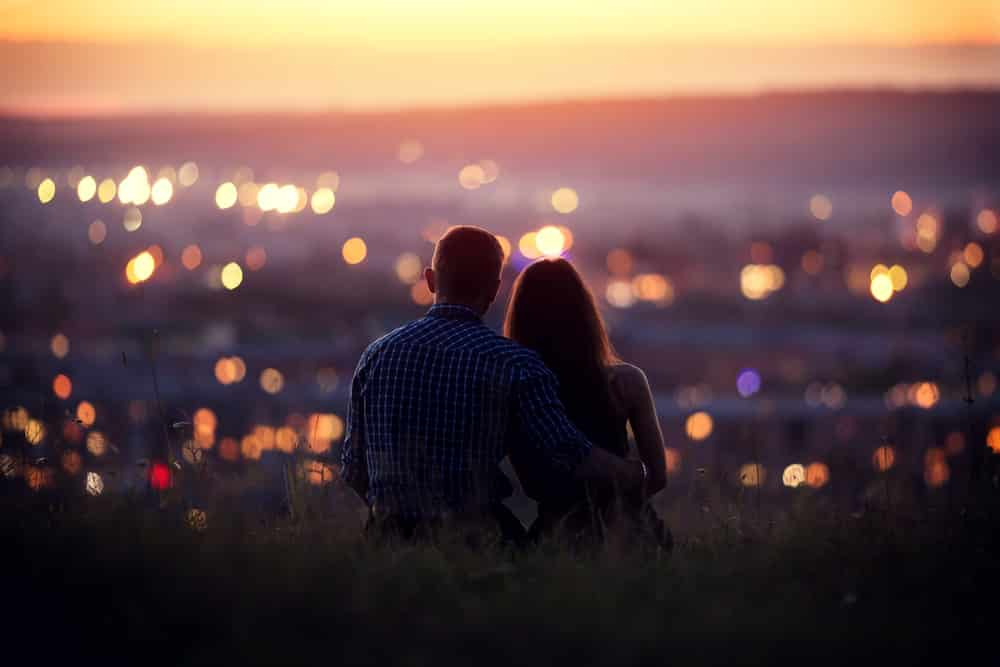 couple-overlooking-city-lights