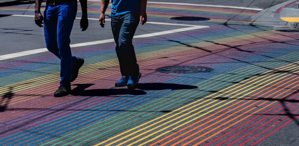 people-crossing-rainbow-crosswalk