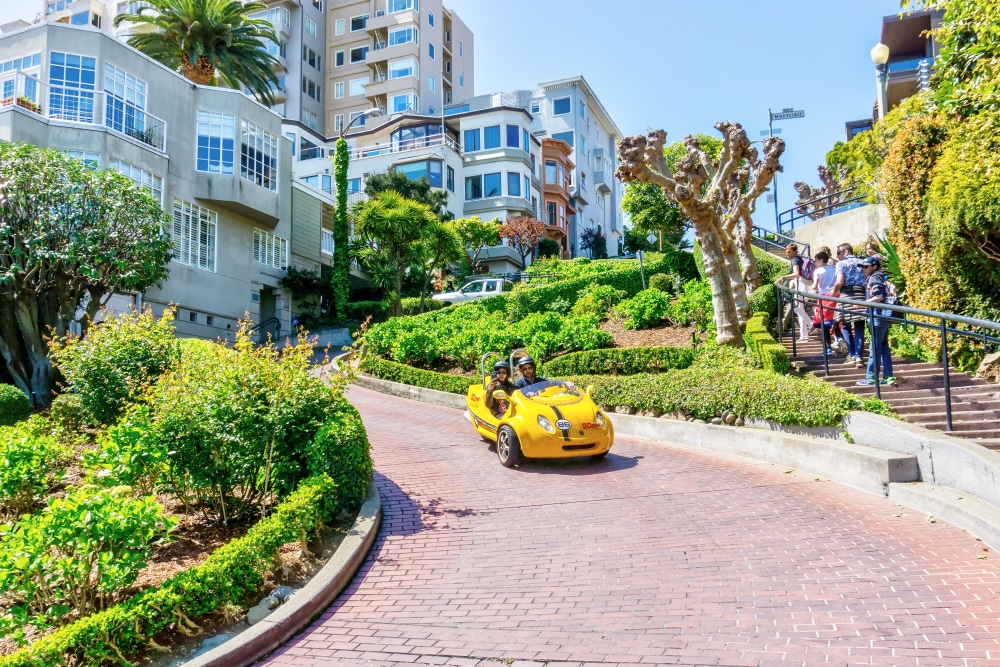yellow-gocar-going-down-lombard-street