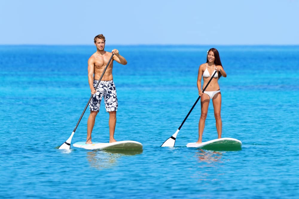 man-and-woman-paddle-boarding