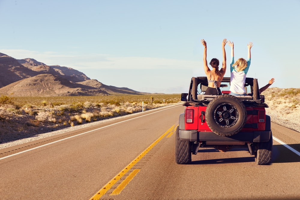friends-riding-a-red-jeep