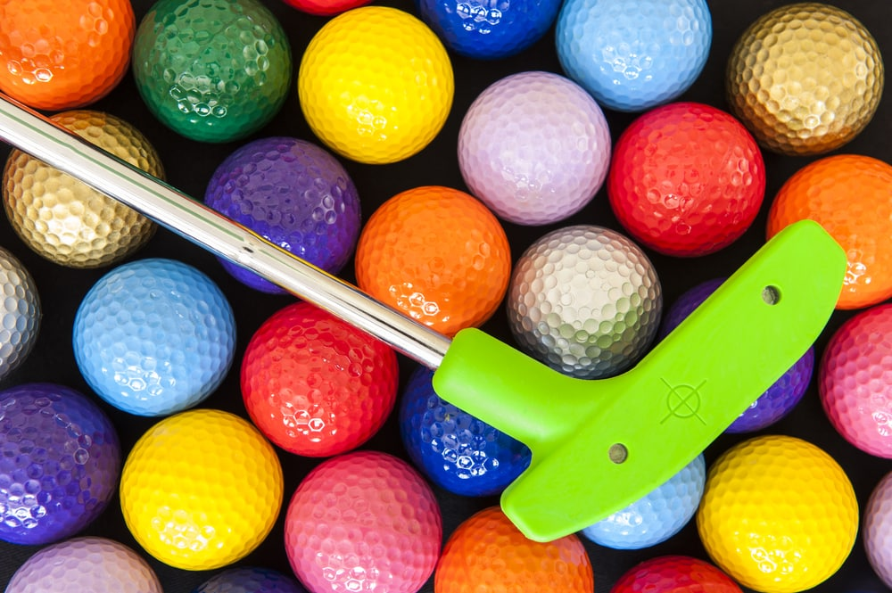 colorful-golf-balls-and-putter