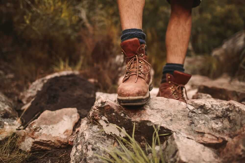 hiker-walking-through-rocks