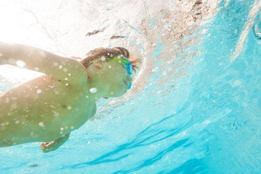 little-boy-swimming-underwater
